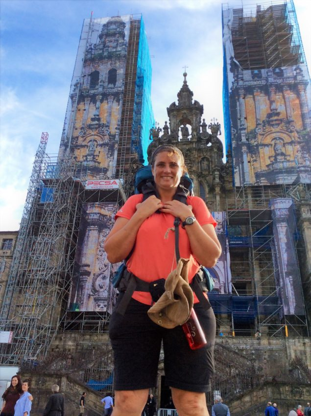 Michelle Ryan standing at the end in front of the Cathedral in Santiago, photo taken by another pilgrim