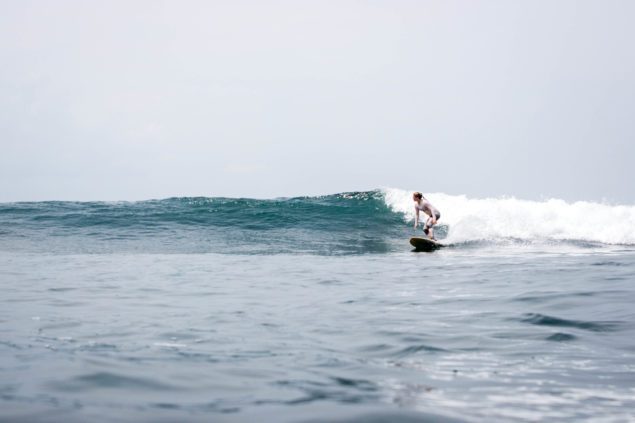 Stephie Buergler surfing in Indonesia. Photo by Deni Firman.