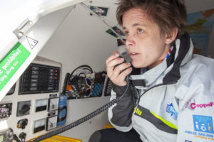 Sarah Outen using a VHF to communicate her location with passing boats in 2015.